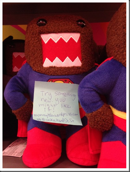 Post-its Project note on a DOMO doll
